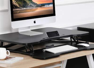 パソコンやキーボードが上がるので、コーヒーマグカップを置ける